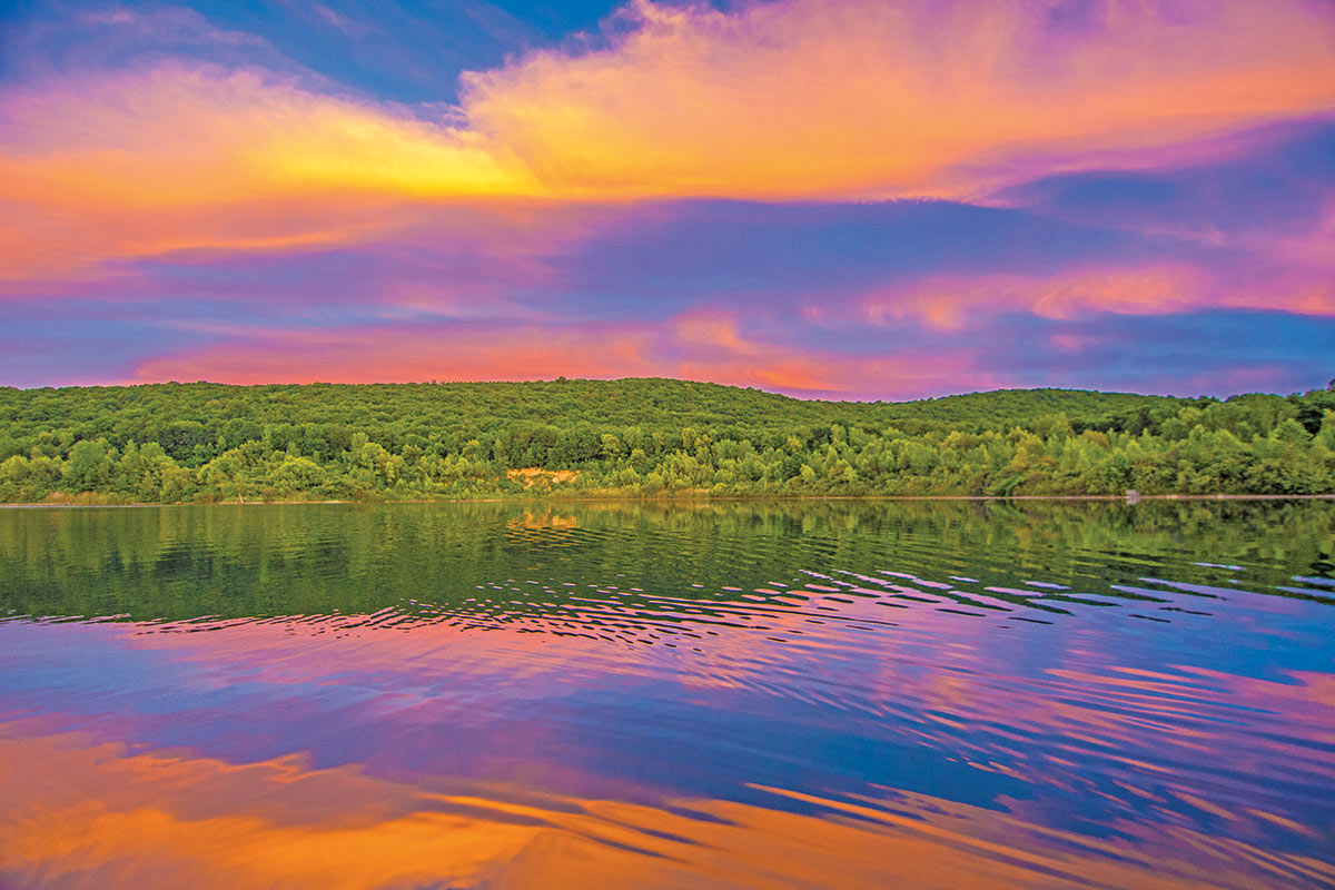Sky over a broad lake surface on sunset