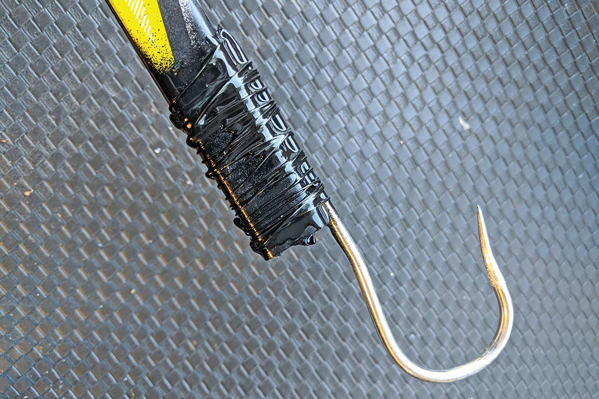 wrap the epoxy, wire, and hook shank; electrical tape, heat shrink, or even paracord/string works fine