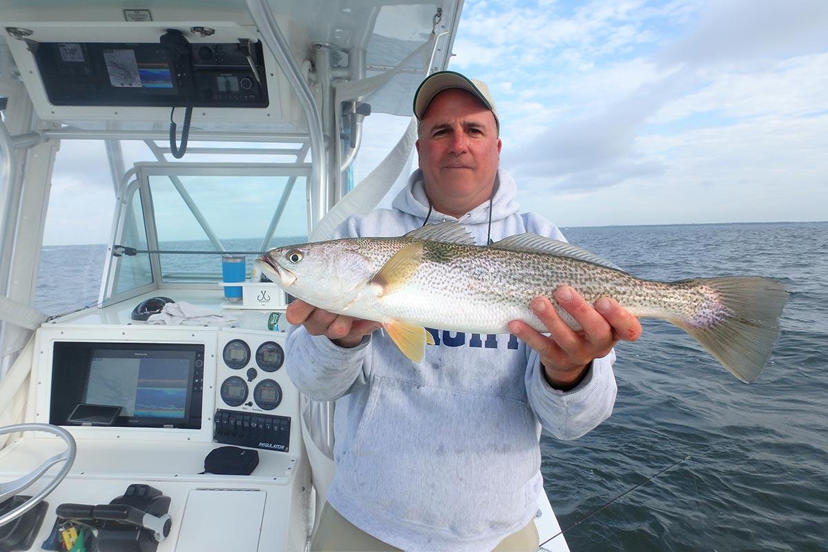 Man showing weakfish