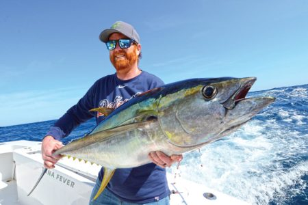 Showing off a huge yellowfin tuna catch.
