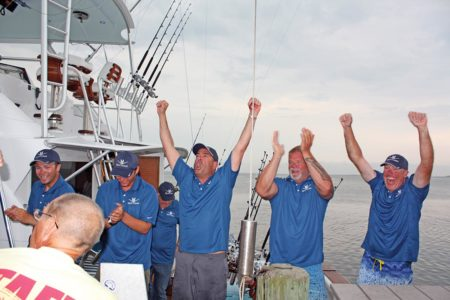 The Melina crew celebrates during the weigh-in of their 356-pound blue marlin at the 49th annual White Marlin Invitational in 2018