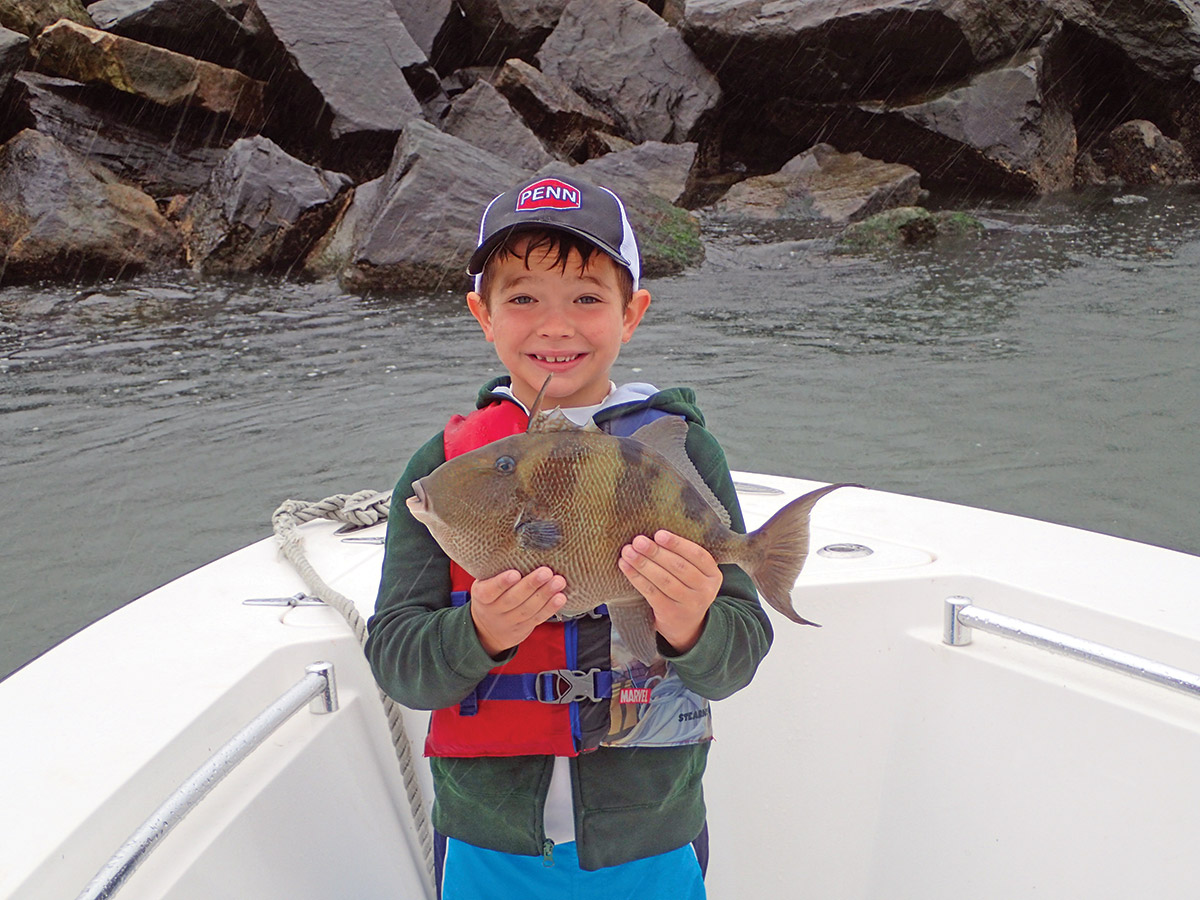 Michael Newhall displays a triggerfish taken along the jetty in Atlantic City Inlet.