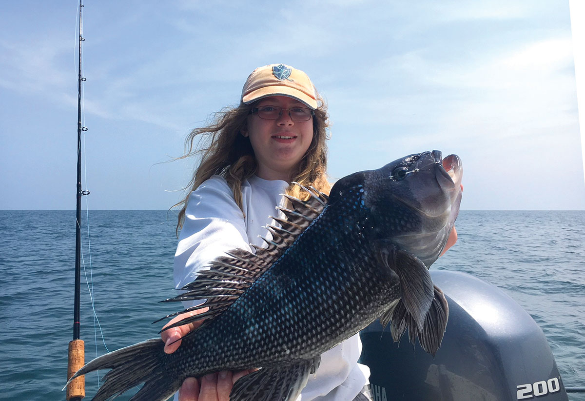 This jumbo sea bass was pulled from deep water structure aboard the Sea Rogue.