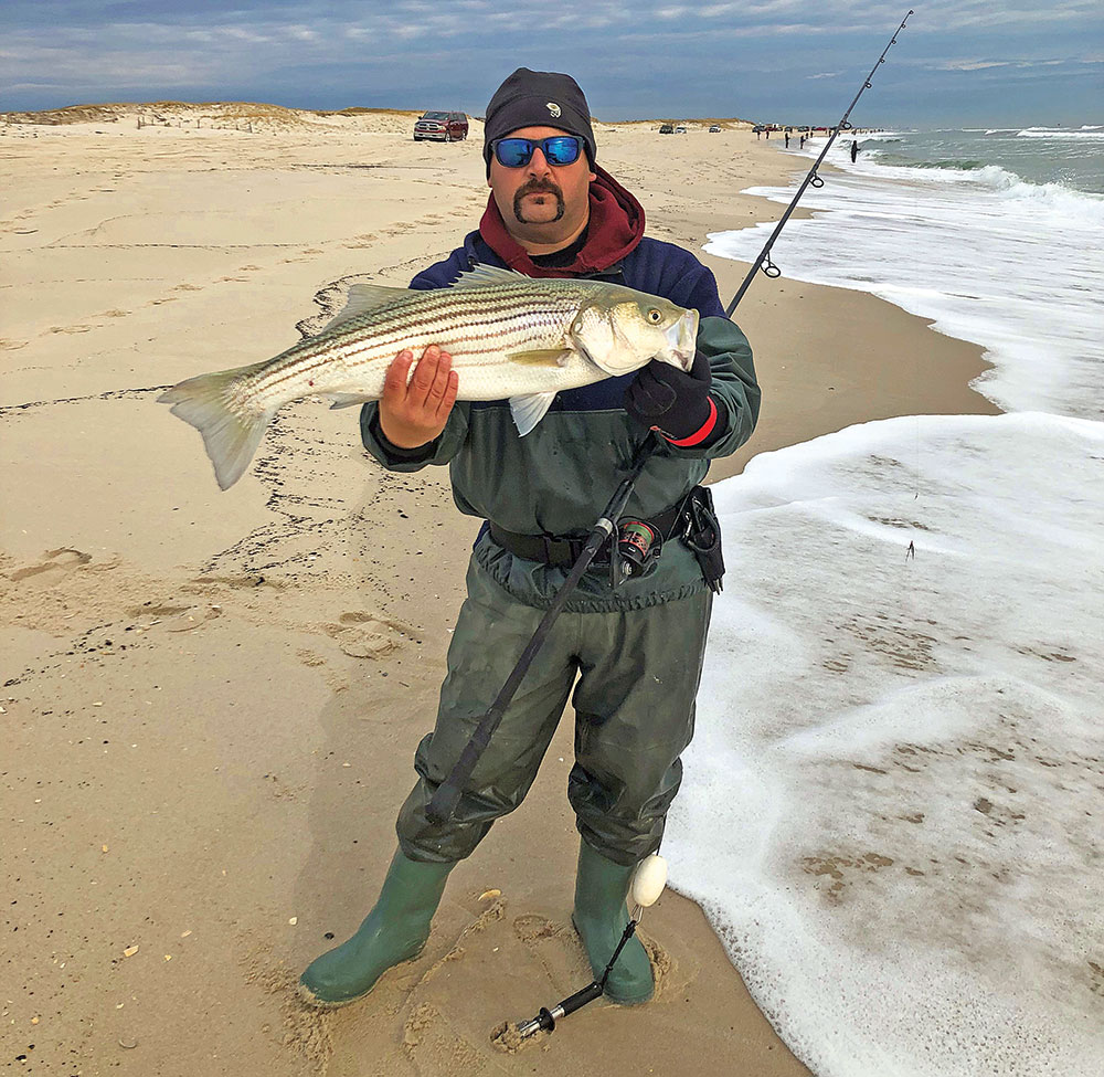 Mike Cateline II with a pre-snow striper caught in 2018 while fishing the beaches between Lavallette and IBSP.