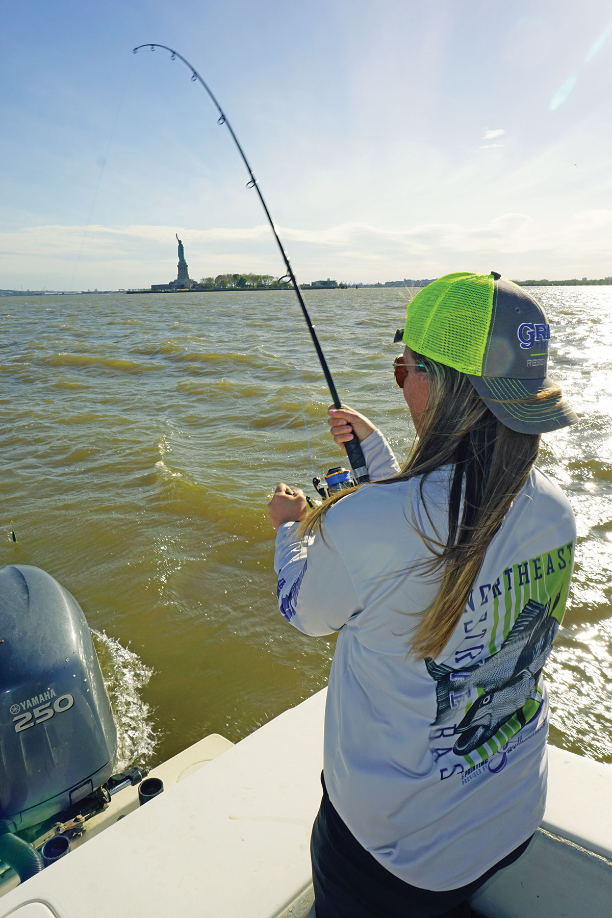 A good striper set to be tagged is reeled in by Leah Baumwell