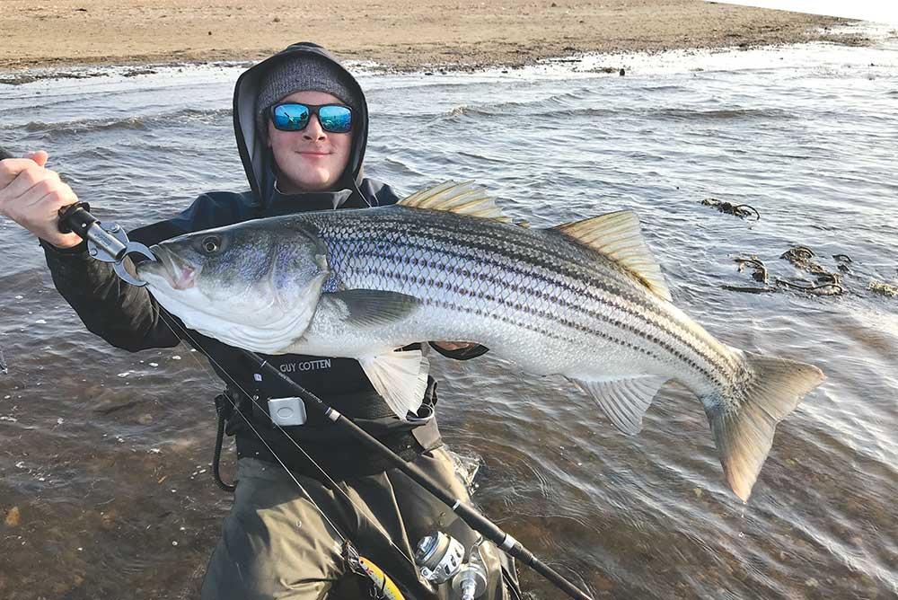 Dan DiPasquale cradles a good fish on the Raritan Bayshore