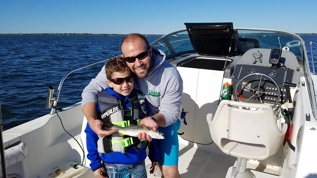 Andrew Muqattash, with his dad Isa, had his first-ever weakfish while targeting blowfish last year off Heckscher.