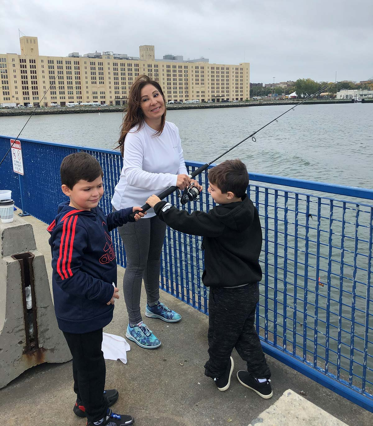 The author and her nephews enjoying a nice day on the water fishing.