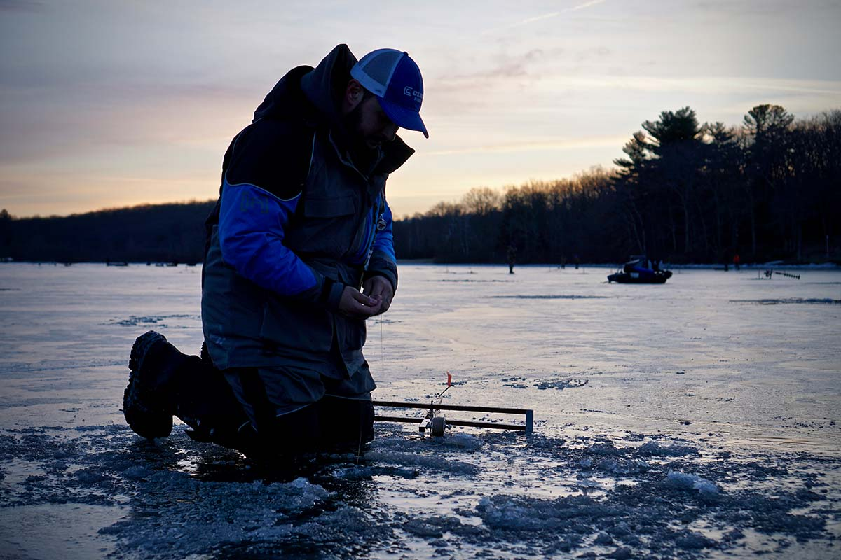 When using a tip-up or trap, a baited line is suspended below the hole. When a fish takes the bait, the spool turns and triggers a flag to pop up, thereby providing a visual cue to the action down below.